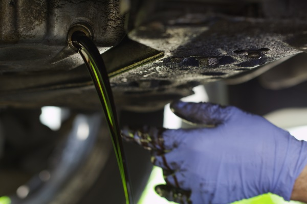 Draining Old Motor Oil